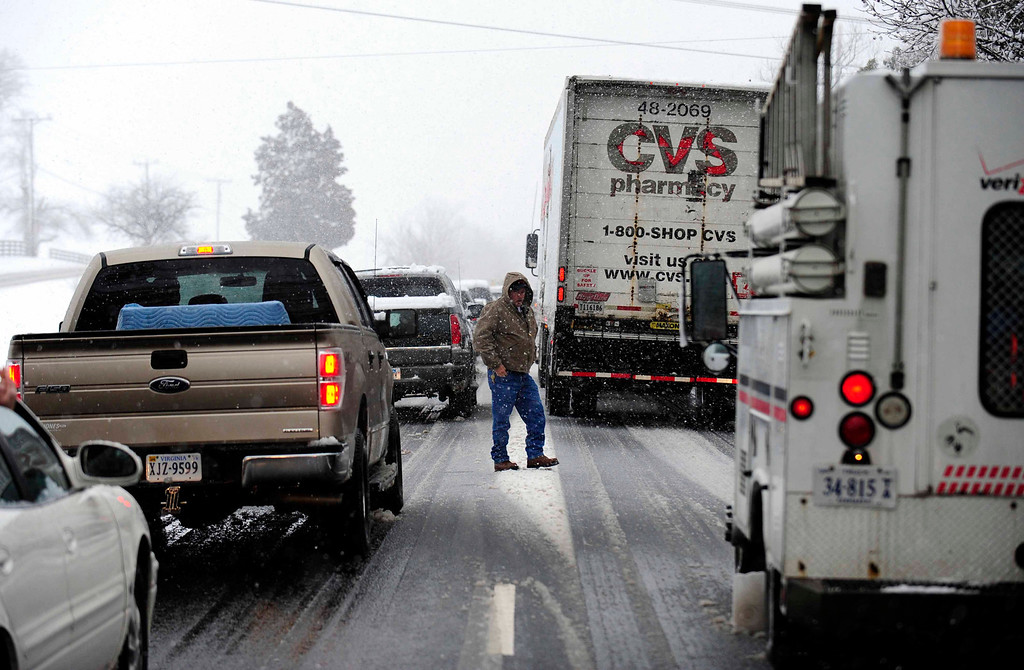 Description of . Traffic is at a stand still on State Route 3 eastbound in Virginia Wednesday March 6, 2013.  A snowstorm blanketed the  region closing schools, county governments and roads. (AP Photo/The Free Lance-Star, Reza A. Marvashti)