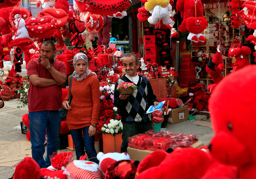 Description of . People shop for Valentine's Day gifts in central Baghdad, Iraq, Thursday, Feb. 14, 2013. (AP Photo/Karim Kadim)