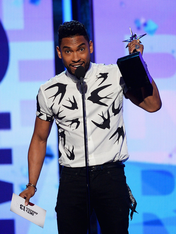 Description of . Recording artist Miguel accepts award onstage during the 2013 BET Awards at Nokia Theatre L.A. Live on June 30, 2013 in Los Angeles, California.  (Photo by Mark Davis/Getty Images for BET)