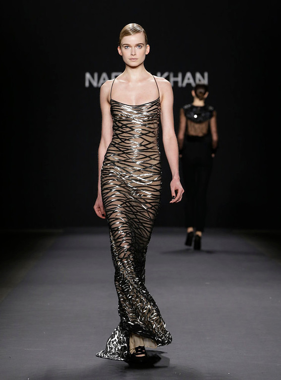 Description of . The Naeem Khan Fall 2013 collection is modeled during Fashion Week in New York, Tuesday, Feb. 12, 2013.  (AP Photo/Kathy Willens)