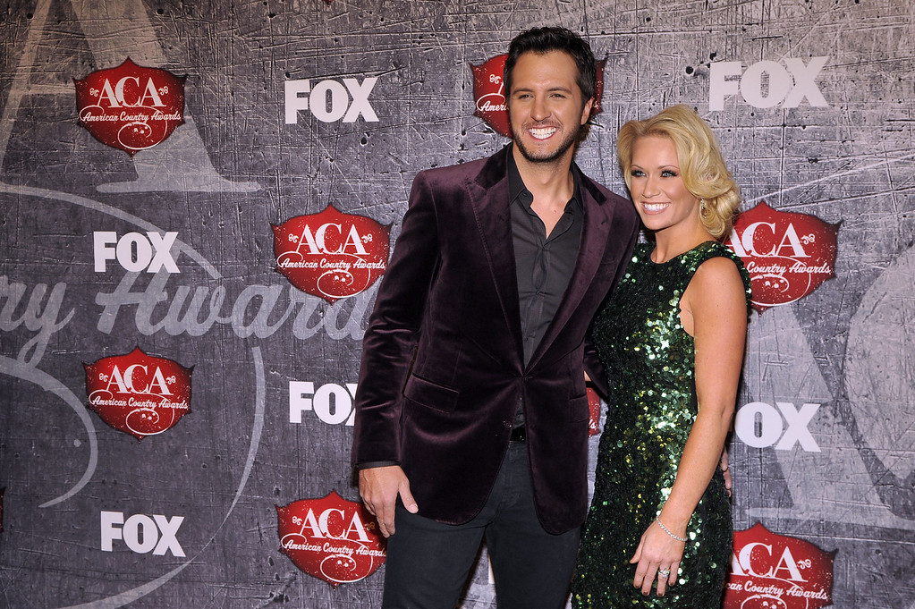 Description of . From left, singer Luke Bryan and Caroline Boyer arrive at the American Country Awards on Monday, Dec. 10, 2012, in Las Vegas. (Photo by Jeff Bottari/Invision/AP)