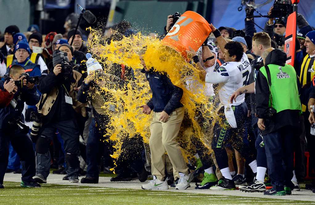 Description of . Seattle Seahawks head coach Pete Carroll has Gatorade dumped on him while the Seahawks defeat the Broncos 43 to 8.  The Denver Broncos vs the Seattle Seahawks in Super Bowl XLVIII at MetLife Stadium in East Rutherford, New Jersey Sunday, February 2, 2014. (Photo by AAron Ontiveroz/The Denver Post)