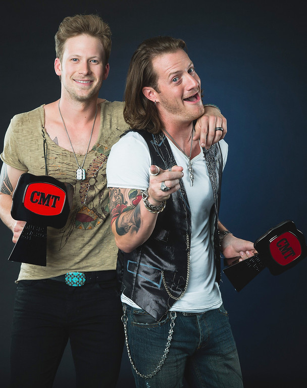 Description of . Brian Kelley(L) and Tyler Hubbard (R) of Florida Georgia Line pose at the 2014 CMT Music Awards - Wonderwall Portrait Studio at Bridgestone Arena on June 4, 2014 in Nashville, Tennessee.  (Photo by Christopher Polk/Getty Images for Wonderwall)