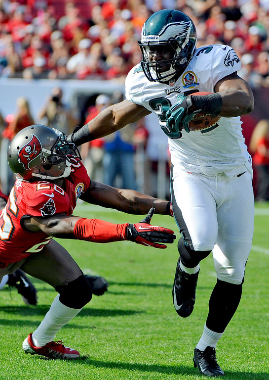 Description of . Philadelphia Eagles running back Bryce Brown (34) fends off Tampa Bay Buccaneers defensive back Anthony Gaitor (26) during the first quarter of an NFL football game, Sunday, Dec. 9, 2012, in Tampa, Fla. (AP Photo/Brian Blanco)