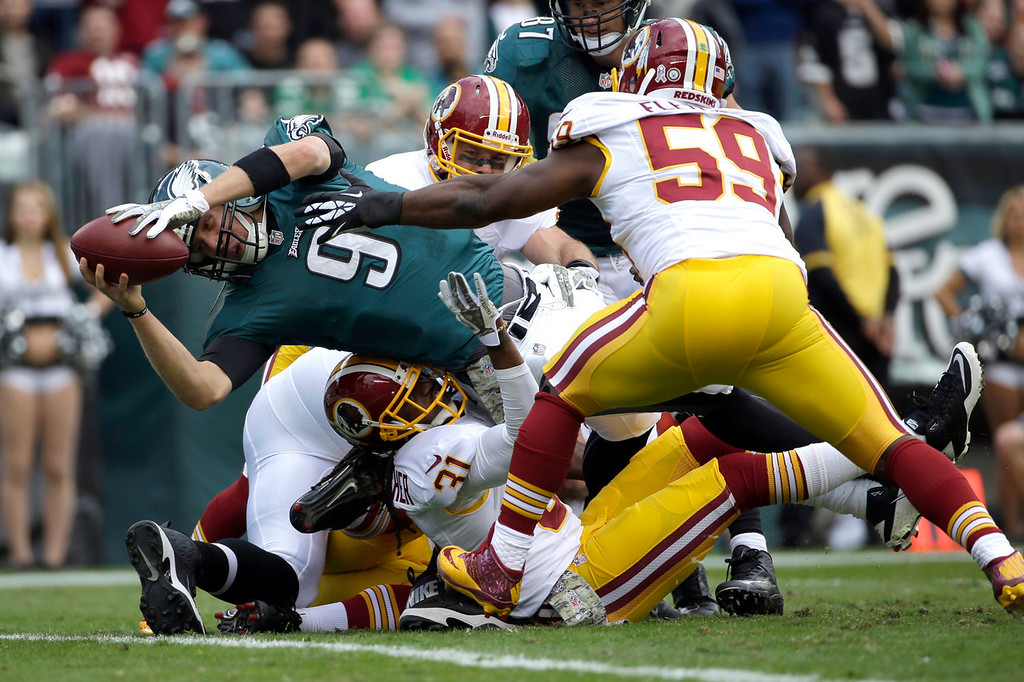 Description of . Philadelphia Eagles quarterback Nick Foles (9) dives into the end zone for a touchdown as Washington Redskins inside linebacker London Fletcher (59) reaches to stop him during the first half of an NFL football game in Philadelphia, Sunday, Nov. 17, 2013. (AP Photo/Matt Slocum)