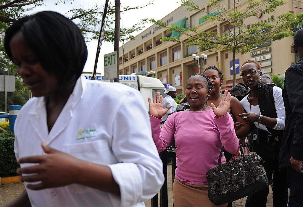 Description of . A woman (2ndL) who had been held hostage reacts following a security operation at an upmarket shopping mall, where suspected terrorists engaged Kenyan security forces in a drawn out gun fight on September 21 2013 in Nairobi. Some 20 people have been killed and about 50 wounded Saturday in the initial attack by the gunmen the Kenya Red Cross said. AFP PHOTO/Tony  KARUMBA/AFP/Getty Images