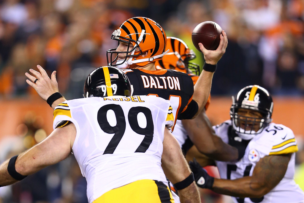 Description of . Quarterback Andy Dalton #14 of the Cincinnati Bengals throws the ball as defensive end Brett Keisel #99 of the Pittsburgh Steelers rushes in during the first quarter at Paul Brown Stadium on September 16, 2013 in Cincinnati, Ohio.  (Photo by Andy Lyons/Getty Images)