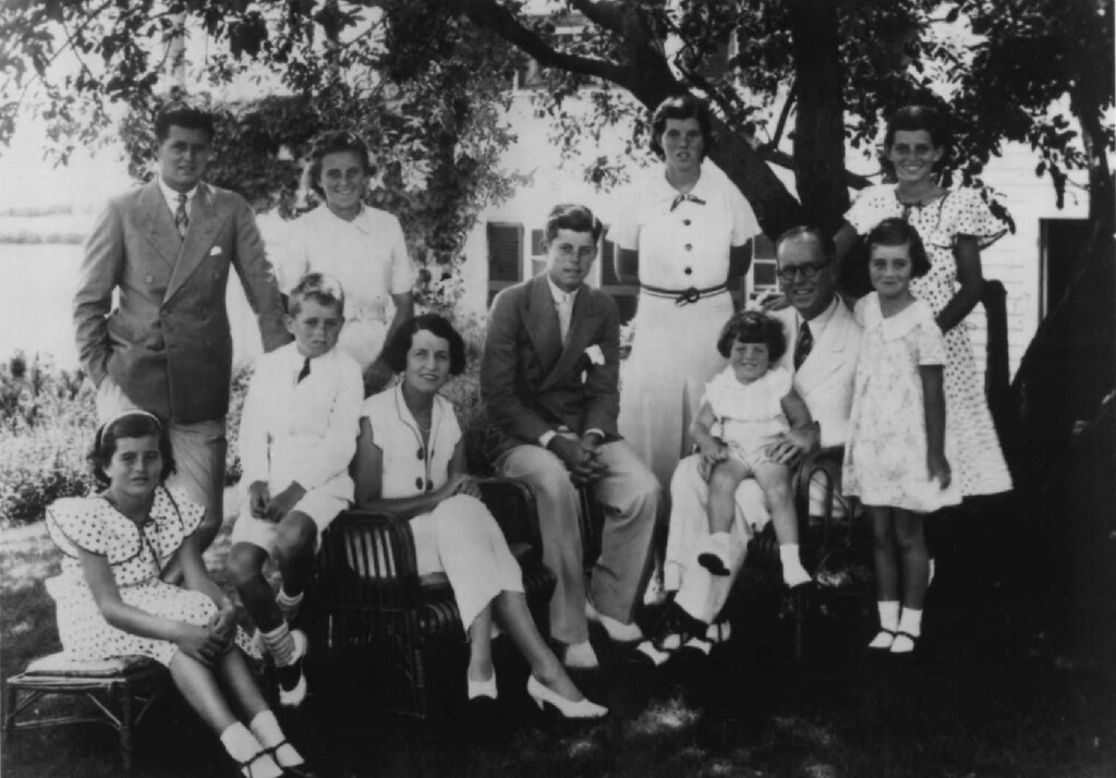 Description of . The Kennedy family gathers for a photo in 1934. From left: Pat, Joe Jr., Bobby, Kathleen, Rose, Jack, Rosemary, Teddy, Joe Sr., Jean and Eurnice. Denver Post file