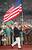 US Olympic wrestler Bruce Baumgartner carries the American flag 19 July during the opening ceremony at the Olympic Stadium in Atlanta. Gabriel BOUYS/AFP/Getty Images