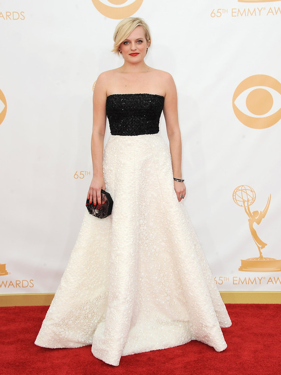 Description of . Elisabeth Moss arrives at the 65th Primetime Emmy Awards at Nokia Theatre on Sunday Sept. 22, 2013, in Los Angeles.  (Photo by Jordan Strauss/Invision/AP)