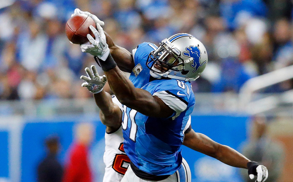 Description of . Detroit Lions wide receiver Calvin Johnson (81), defended by Tampa Bay Buccaneers cornerback Johnthan Banks, catches a 21-yard reception during the third quarter of an NFL football game at Ford Field in Detroit, Sunday, Nov. 24, 2013. (AP Photo/Rick Osentoski)