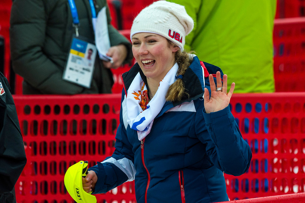 Description of . Mikaela Shiffrin, of Eagle-Vail, Colo., waves to friends after competing in run 1 of the women's slalom competition at Rosa Khutor Alpine Center during the 2014 Sochi Olympics Friday February 21, 2014. Shiffrin is currently winning with a time of 52.62. (Photo by Chris Detrick/The Salt Lake Tribune)