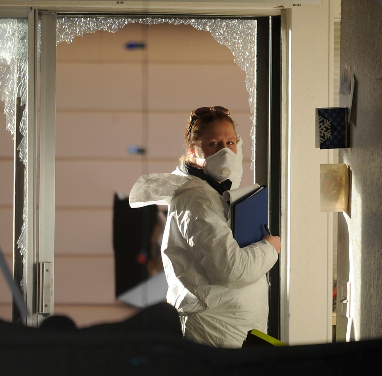 Description of . Christmas cards were visible inside the Aurora townhome where Aurora crime investigators gathered evidence after four people died Saturday morning, January 5, 2013. Four people were killed including a gunman who held police at bay for several hours in an Aurora townhome. Neighbors identified the gunman as Sonny Archuleta. Karl Gehring/The Denver Post
