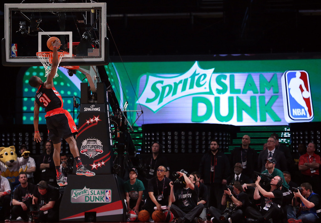 Description of . HOUSTON, TX - FEBRUARY 16:  Terrence Ross of the Toronto Raptors goes up for a dunk in the first round during the Sprite Slam Dunk Contest part of 2013 NBA All-Star Weekend at the Toyota Center on February 16, 2013 in Houston, Texas.  (Photo by Ronald Martinez/Getty Images)