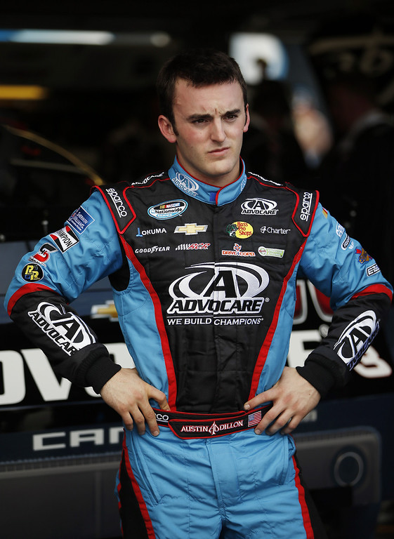 Description of . Austin Dillon, driver of the #3 AdvoCare Chevrolet, stands in the garage during practice for the NASCAR Nationwide Series DRIVE4COPD 300 at Daytona International Speedway on February 21, 2013 in Daytona Beach, Florida.  (Photo by Chris Graythen/Getty Images)