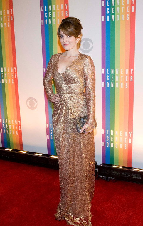 Description of . Actress Tina Fey arrives at the Kennedy Center for the Performing Arts for the 2012 Kennedy Center Honors Performance and Gala Sunday, Dec. 2, 2012 at the State Department in Washington. (AP Photo/Kevin Wolf)
