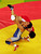 Kyoko Hamaguchi (blue) of Japan flips Xu Wang of China during the women's Freestyle wrestling 72 kg Semi Final round on August 23, 2004 during the Athens 2004 Summer Olympic Games at Ano Liossia Olympic Hall in Athens, Greece. (Photo by Al Bello/Getty Images)