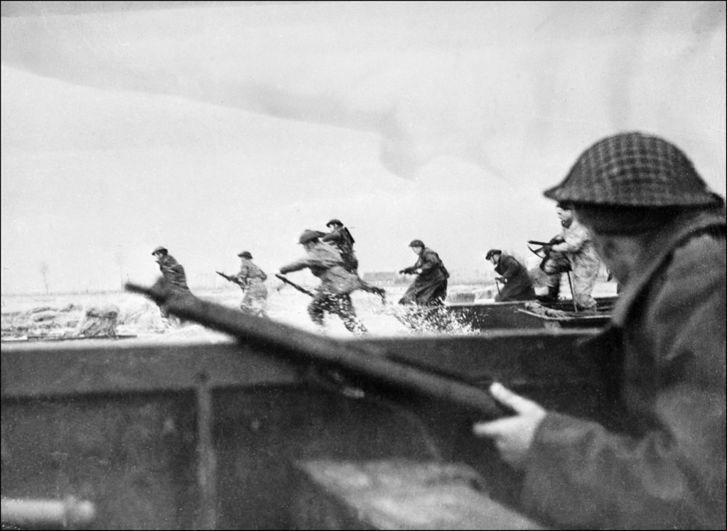 Description of . Canadian soldiers land on Courseulles beach in Normandy, June 6, 1944 as Allied forces storm the Normandy beaches on D-Day. (STF/AFP/Getty Images)