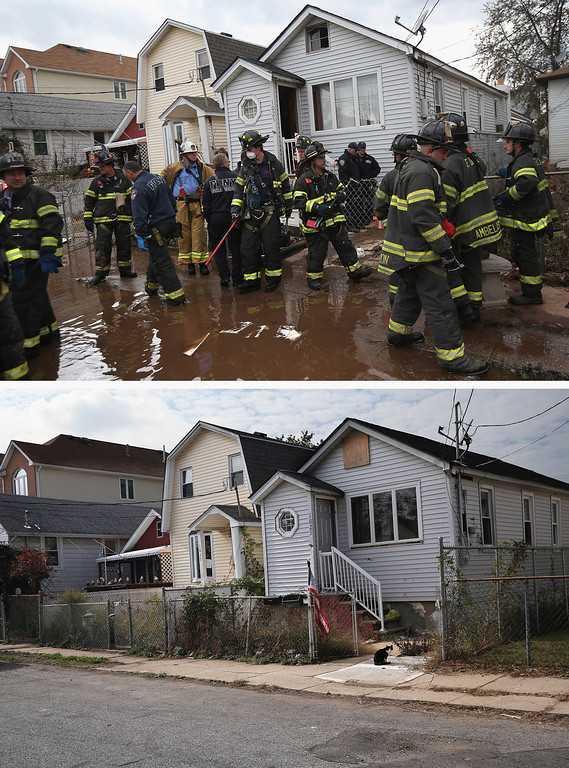 Description of . NEW YORK, NY - NOVEMBER 02: (top)  Firemen gather outside a house where the bodies of two elderly people were reportedly found on November 2, 2012 in the Midland Beach section of the Staten Island borough of New York City. NEW YORK, NY - OCTOBER 17:  (bottom)  A cat sits outside a home on October 17, 2013 in the Midland Beach section of the Staten Island borough of New York City. Hurricane Sandy made landfall on October 29, 2012 near Brigantine, New Jersey and affected 24 states from Florida to Maine and cost the country an estimated $65 billion.  (Photos by John Moore/Getty Images)