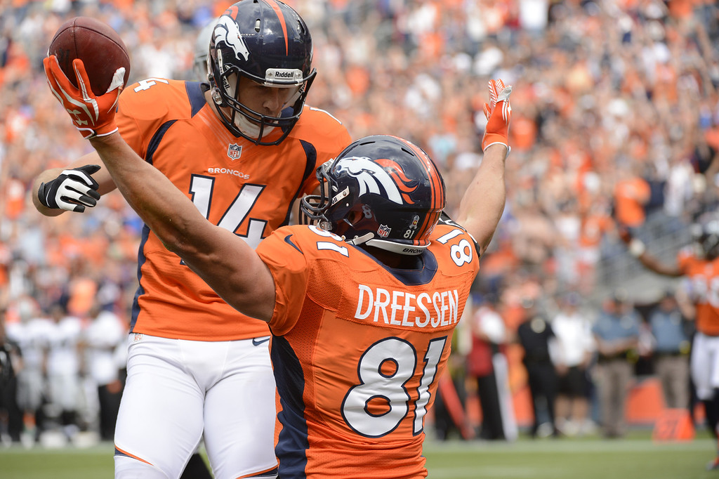 Description of . Joel Dreessen celebrates with Brandon Stokley after catching a pass for a Broncos touchdown in the first quarter during the Denver Broncos game against the Oakland Raiders at Sports Authority Field at Mile High on Sunday, September 30, 2012. Joe Amon, The Denver Post