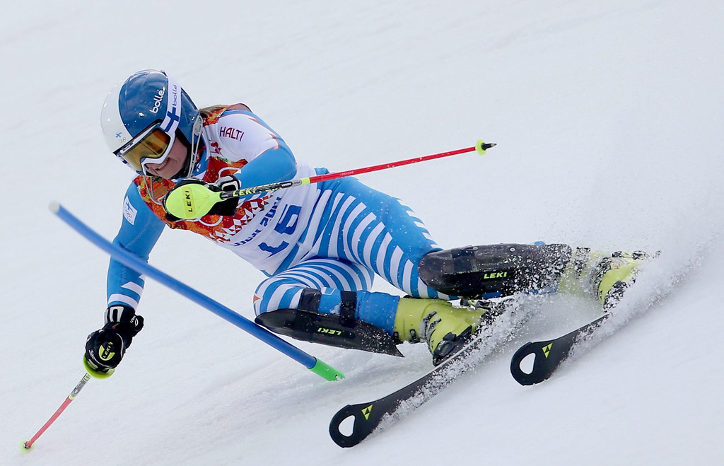 Description of . Tanja Poutiainen of Finland in action during the first run of the Women's Slalom race at the Rosa Khutor Alpine Center during the Sochi 2014 Olympic Games, Krasnaya Polyana, Russia, 21 February 2014.  EPA/KARL-JOSEF HILDENBRAND