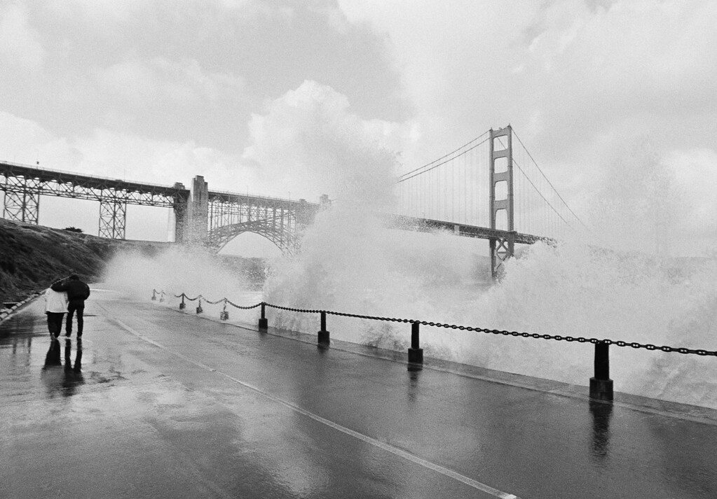 Description of . The scenic view at Ford Point was a wet one after a Pacific storm with winds gusting to more than 55 mph whipped through the Golden Gate in San Francisco, California, on Tuesday, Dec. 1, 1982. The storm toppled trees and left many Bay Area residents without power. (AP Photo/Eric Risberg)