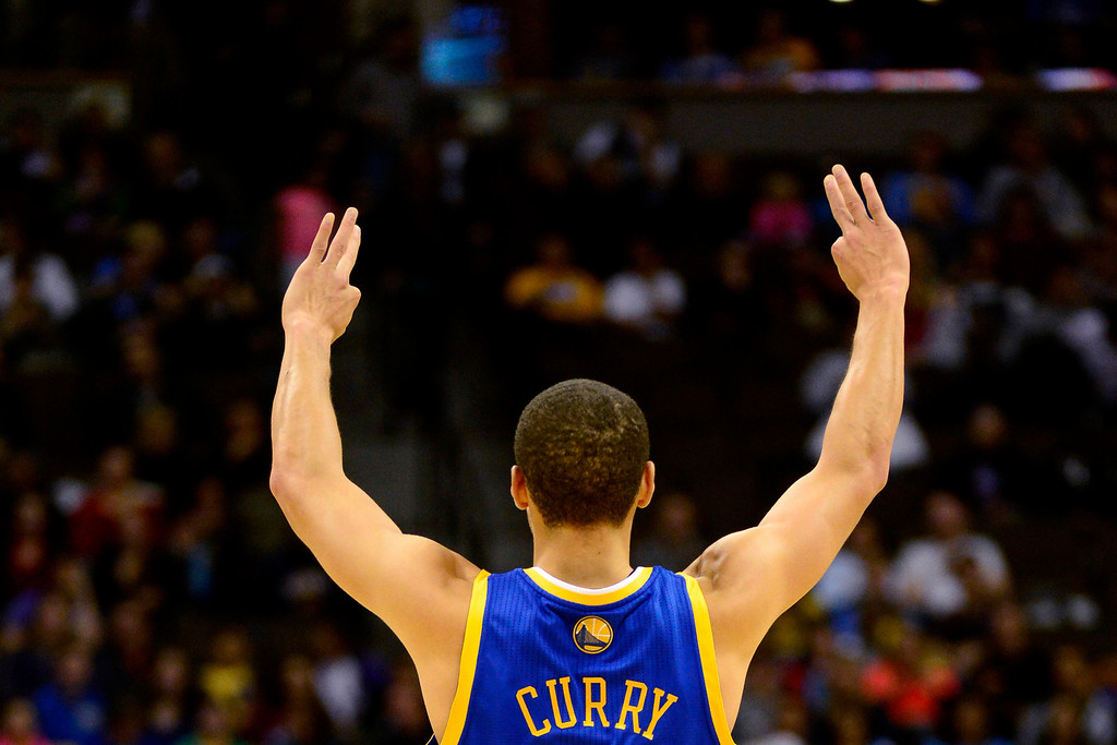 Description of . Golden State Warriors point guard Stephen Curry (30) celebrates a three-pointer against the Denver Nuggets during the first half at the Pepsi Center on Sunday, January 13, 2013. AAron Ontiveroz, The Denver Post