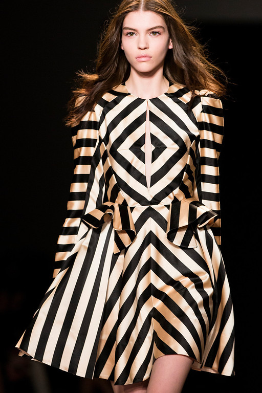 . A model walks the runway at the presentation of the Jill Stuart Fall 2013 fashion collection during Fashion Week, Saturday, Feb. 9, 2013, in New York. (AP Photo/John Minchillo)