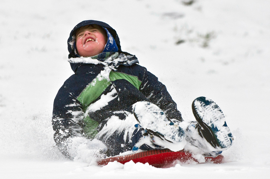 Description of . Jack Erwin, 6, has fun making snow angels Wednesday, March 6, 2013., in Danville, Ky., behind Danville High School. (AP Photo/The Advocate Messenger, Clay Jackson)