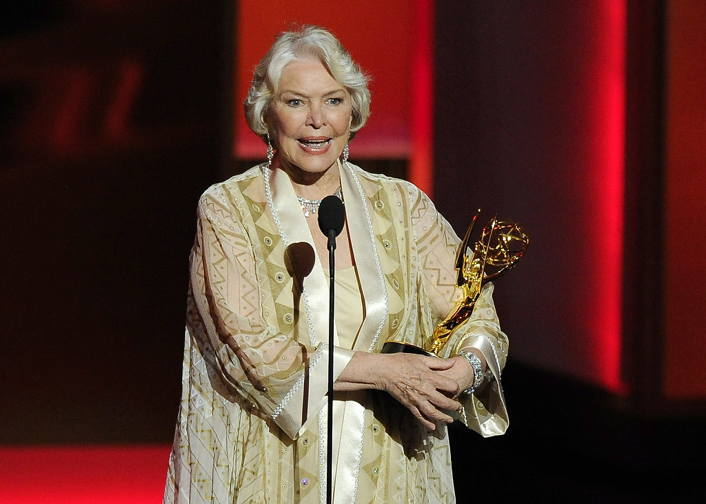 Description of . Ellen Burstyn accepts the award for outstanding supporting actress in a miniseries or a movie for her role on ìPolitical Animalsî at the 65th Primetime Emmy Awards at Nokia Theatre on Sunday Sept. 22, 2013, in Los Angeles.  (Photo by Chris Pizzello/Invision/AP)