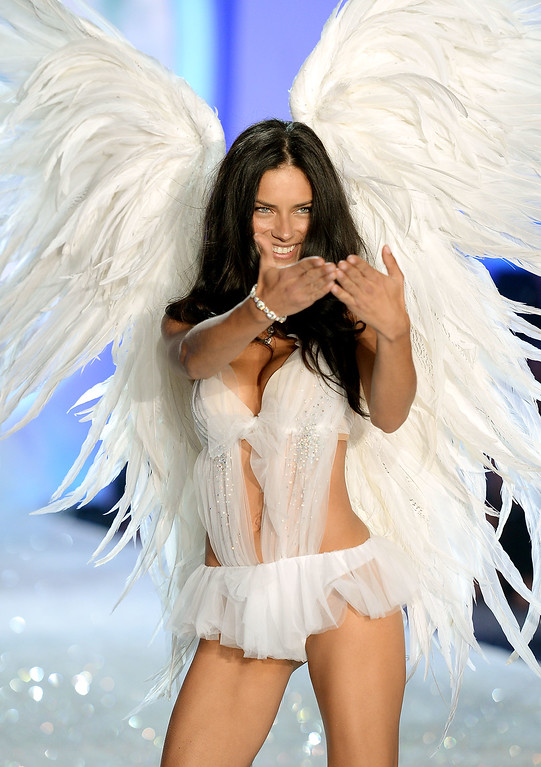 Description of . Model Adriana Lima walks the runway at the 2013 Victoria's Secret Fashion Show at Lexington Avenue Armory on November 13, 2013 in New York City.  (Photo by Dimitrios Kambouris/Getty Images for Victoria's Secret)
