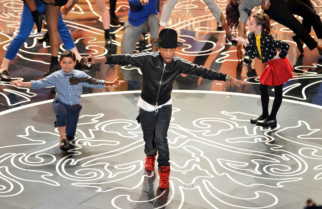 Description of . Singer Pharrell Williams performs onstage during the Oscars at the Dolby Theatre on March 2, 2014 in Hollywood, California.  (Photo by Kevin Winter/Getty Images)