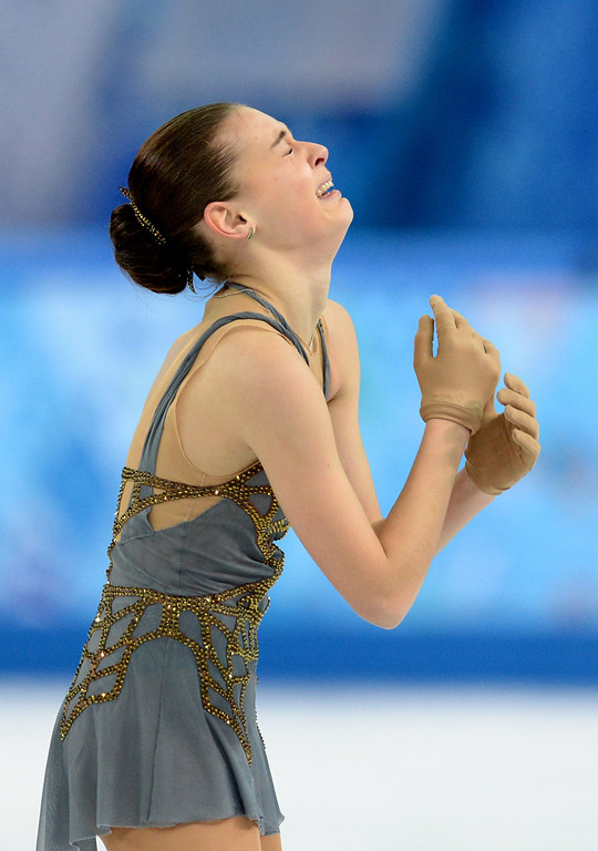Description of . Russia's Adelina Sotnikova reacts after performing in the Women's Figure Skating Free Program at the Iceberg Skating Palace during the Sochi Winter Olympics on February 20, 2014. YURI KADOBNOV/AFP/Getty Images