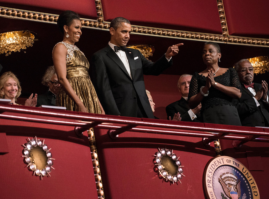 Description of . US President Barack Obama and US First Lady Michelle Obama arrive for the 2012 Kennedy Center Honors at the Kennedy Center December 2, 2012 in Washington, DC.  Robert Plant of Led Zeppelin, Jimmy Page of Led Zeppelin, John Paul Jones of Led Zeppelin,  ballerina Natalia Makarova, comedian and late night talk show host David Letterman, actor Dustin Hoffman and Blues musician Buddy Guy were each honored for their lifetime contributions to the arts.  BRENDAN SMIALOWSKI/AFP/Getty Images
