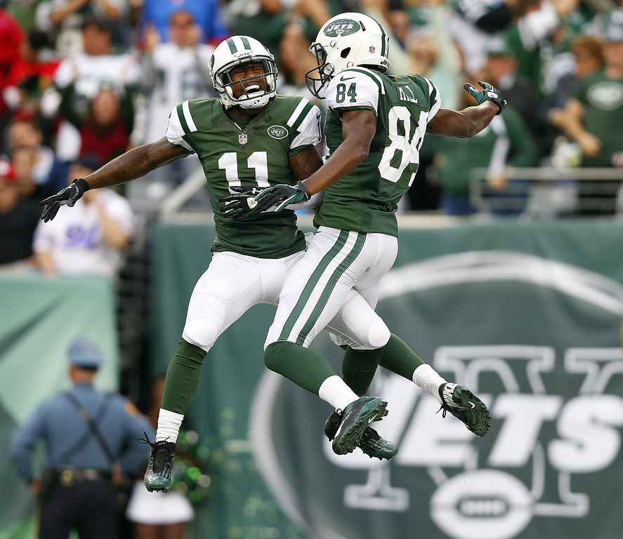 Description of . Wide receiver Stephen Hill #84 of the New York Jets celebrates his 51 yard touchdown catch with teammate Jeremy Kerley #11 against the Buffalo Bills quarter during the second quarter in a game at MetLife Stadium on September 22, 2013 in East Rutherford, New Jersey. (Photo by Rich Schultz /Getty Images)