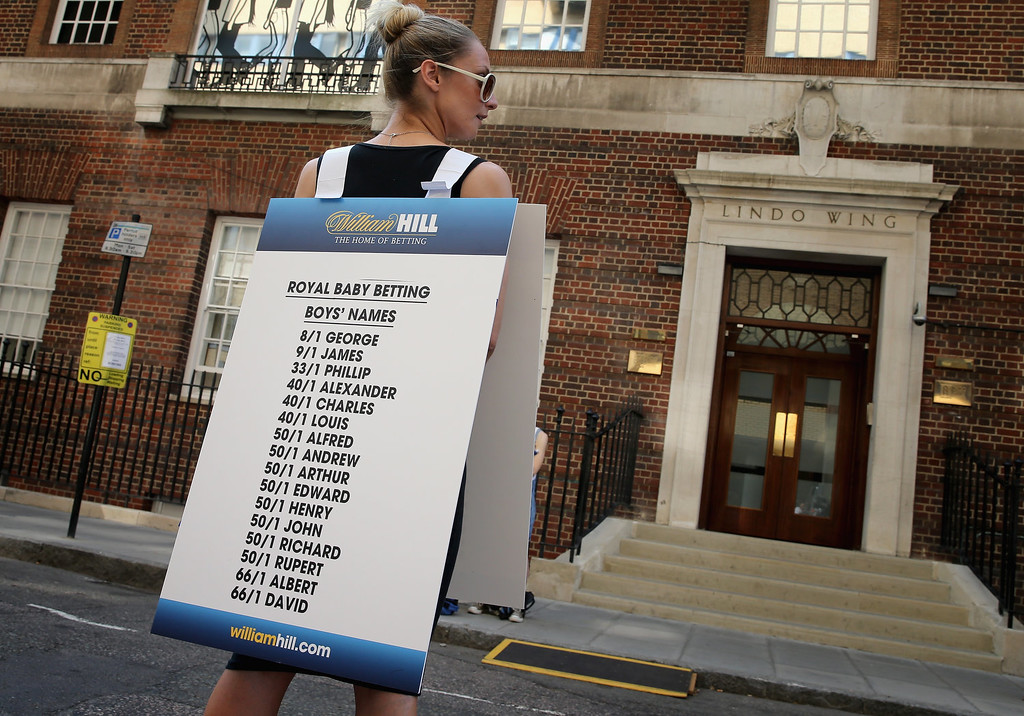 Description of . A girl from a Betting Company wears a board highlighting the latest odds on babies names outside the Lindo wing of St Mary\'s Hospital as the UK prepares for the birth of the first child of The Duke and Duchess of Cambridge on July 16, 2013 in London, England.  (Photo by Chris Jackson/Getty Images)