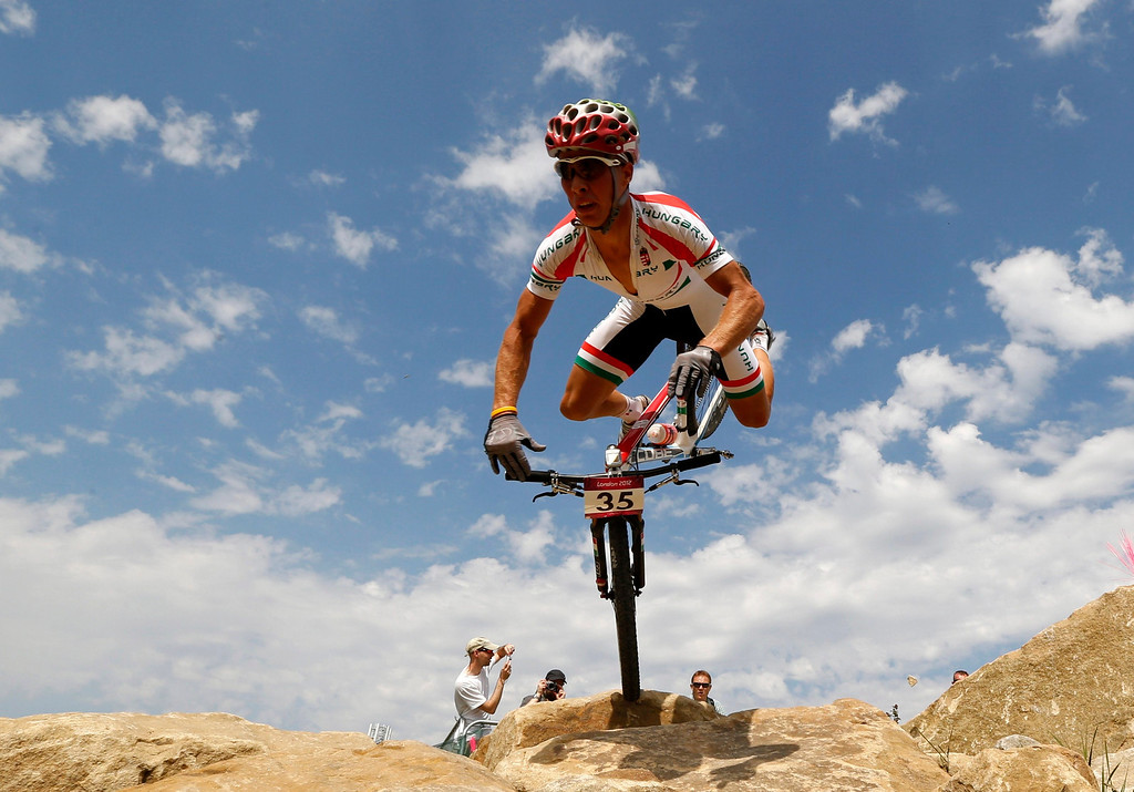 Description of . Hungary's Andras Parti reacts as he falls during the men's cross-country mountain bike event at Hadleigh Farm during the London 2012 Olympic Games August 12, 2012.  REUTERS/Stefano Rellandini