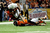 Johnathan Gray #32 of the University of Texas Longhorns is brought down by D.J. Alexander #4 of the Oregon State Beavers during the Valero Alamo Bowl at the Alamodome on December 29, 2012 in San Antonio, Texas.  (Photo by Stacy Revere/Getty Images)