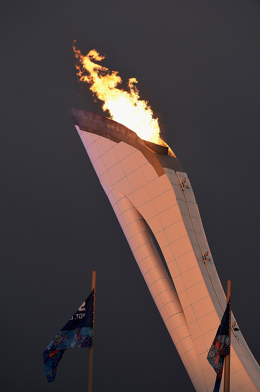 Description of . The Olympic torch burns in the cauldron outside the Ice Cube Curling Center on February 11, 2014 in Sochi, Russia.  (Photo by Pascal Le Segretain/Getty Images)