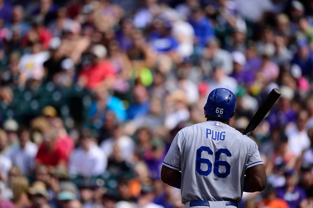 Description of . Yasiel Puig (66) of the Los Angeles Dodgers waits to bat against Chad Bettis (35) of the Colorado Rockies during the action in Denver on Monday, September 2, 2013. The Colorado Rockies hosted the Los Angeles Dodgers at Coors Field.   (Photo by AAron Ontiveroz/The Denver Post)
