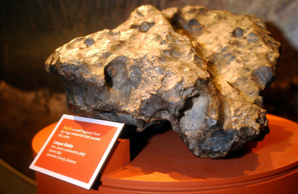 Description of . A fragment of a meteorite found in 1891 in Arizona, is shown on display at the  TCU Oscar E. Monnig Meteor Gallery in Fort Worth, Texas, Monday, Feb. 3, 2003. The state's only museum dedicated to meteorites, showcases nearly 200 space rocks found worldwide since the 15th century. (AP Photo/Jennifer Long)