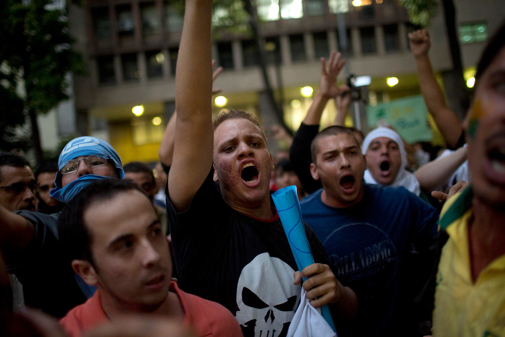Description of . Protestors march in Rio de Janeiro, Brazil, Monday, June 17, 2013. Protests in Sao Paulo, Rio de Janeiro and other Brazilian cities, were set off by a 10-cent hike in public transport fares, have clearly moved beyond that issue to tap into widespread frustration in Brazil about a heavy tax burden, politicians widely viewed as corrupt and woeful public education, health and transport systems and come as the nation hosts the Confederations Cup soccer tournament and prepares for next month's papal visit. (AP Photo/Felipe Dana)