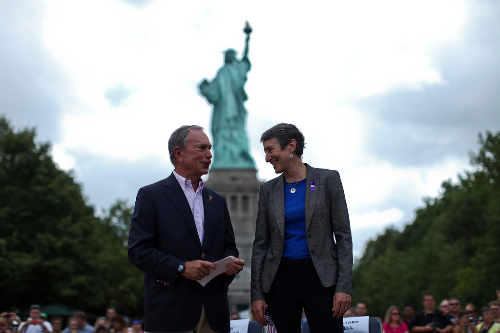 Description of . Secretary of the Interior Sally Jewell (R) speaks with New York City Mayor Michael Bloomberg while they attend a ceremony to reopen the Statue of Liberty and Liberty Island to the public in New York July 4, 2013. Under steamy summer skies, tourists in New York flocked to ferries headed for the Statue of Liberty, re-opening with an Independence Day ceremony after closing in October as Superstorm Sandy approached.  REUTERS/Eduardo Munoz