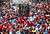 Thousands of supporters of the late Venezuelan President Hugo Chavez accompany the funeral cortege on its way to the Military Academy, on March 6, 2013, in Caracas. The flag-draped coffin of Venezuelan leader Hugo Chavez was borne through throngs of weeping supporters on Wednesday as a nation bade farewell to the firebrand leftist who led them for 14 years. AFP PHOTO/Juan  BARRETO/AFP/Getty Images