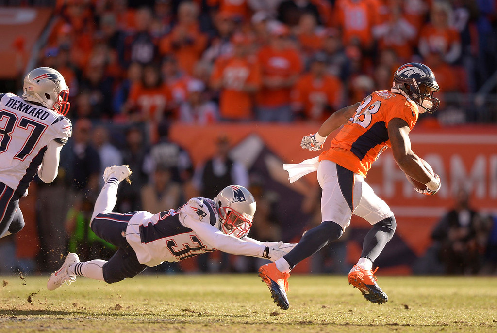 Description of . Denver Broncos wide receiver Demaryius Thomas (88) runs away from New England Patriots free safety Devin McCourty (32) during the second quarter. The Denver Broncos vs. The New England Patriots in an AFC Championship game  at Sports Authority Field at Mile High in Denver on January 19, 2014. (Photo by John Leyba/The Denver Post)