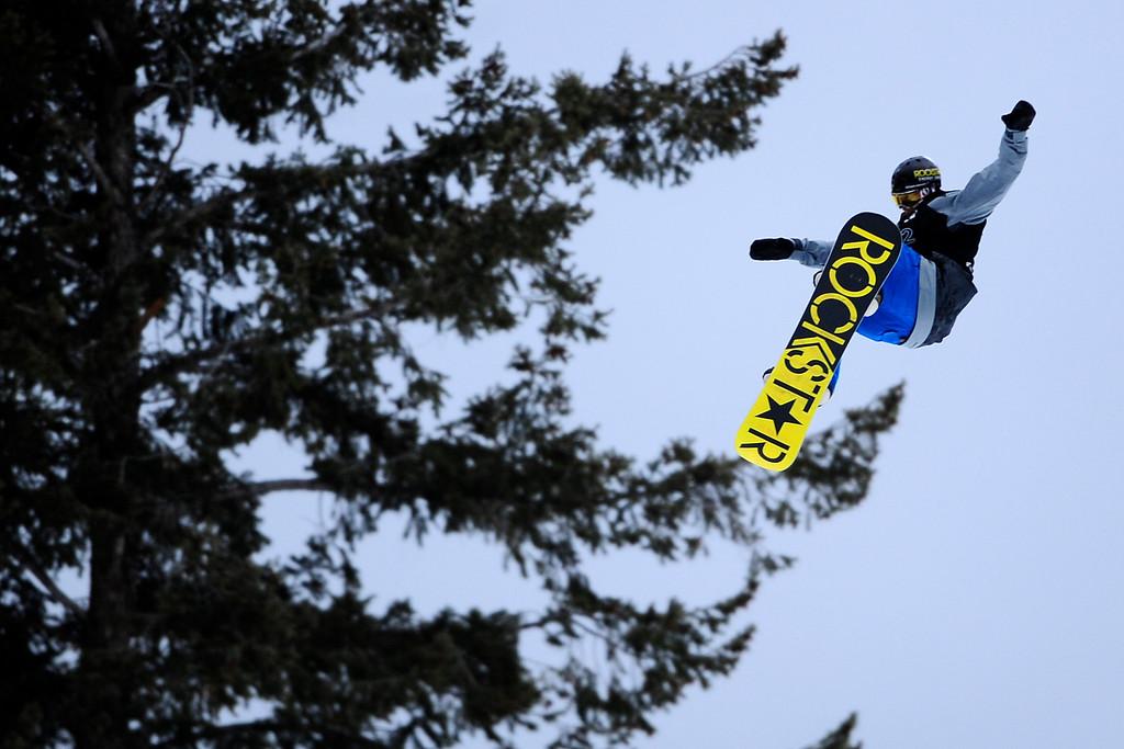Description of . ASPEN, CO. - JANUARY 24: Chas Guldemond hits a jump during the men's Snowboard Slopestyle elimination. Men's Snowboard Slopestyle elimination X Games Aspen Buttermilk Mountain Aspen January 24, 2013. (Photo By AAron Ontiveroz / The Denver Post)