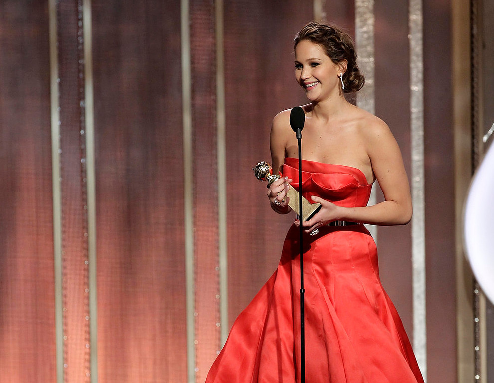 Description of . This image released by NBC shows actress Jennifer Lawrence with her award for best actress in in a motion picture comedy or musical for her role in