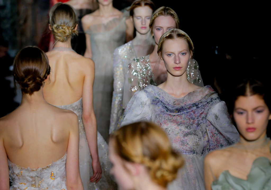 Description of . Models wear creations by fashion designers Maria Grazia Chiuri and Pier Paolo Piccioli for Valentino as part of the Women's Spring/Summer 2013 Haute Couture fashion collection presented in Paris, Wednesday, Jan. 23 2013 (AP Photo/ Jacques Brinon)