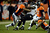 Denver Broncos cornerback Chris Harris (25) takes down Baltimore Ravens fullback Vonta Leach (44) during the fourth quarter.  The Denver Broncos vs Baltimore Ravens AFC Divisional playoff game at Sports Authority Field Saturday January 12, 2013. (Photo by Joe Amon,/The Denver Post)