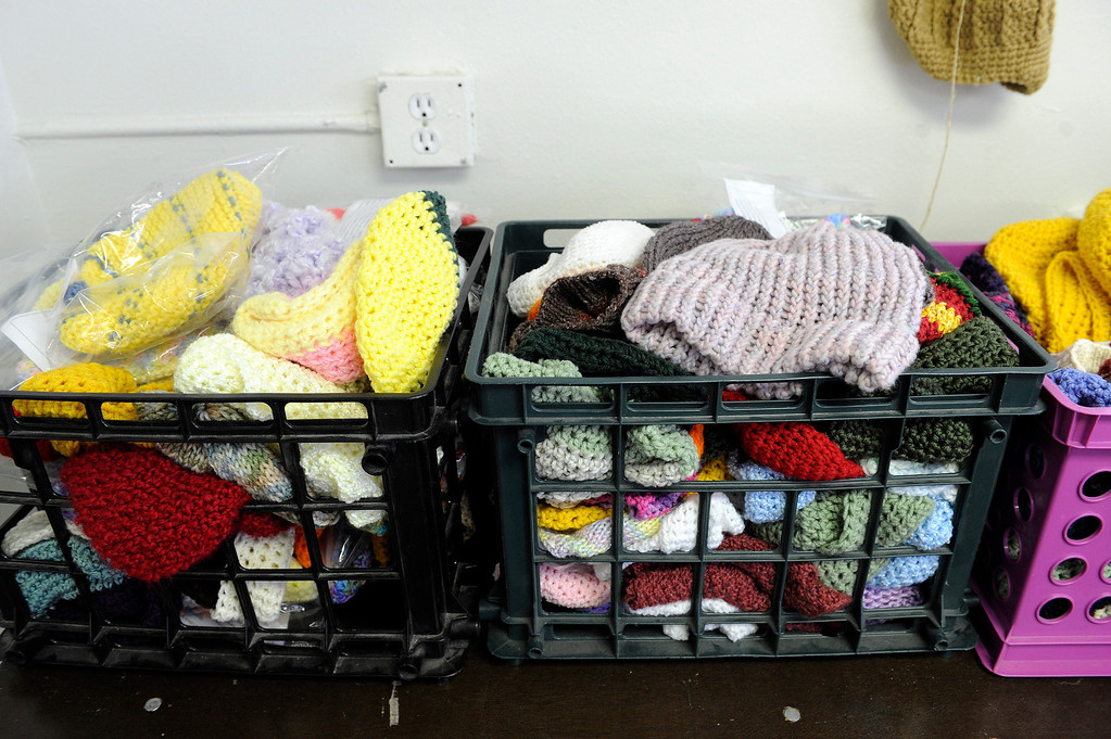 Description of . AURORA, CO - NOVEMBER 21: A supply of hand-knit hats sits in baskets, waiting to be distributed to homeless clients at the Aurora Warms the Night facility on November 21, 2013, in Aurora, Colorado. (Photo by Anya Semenoff/YourHub)